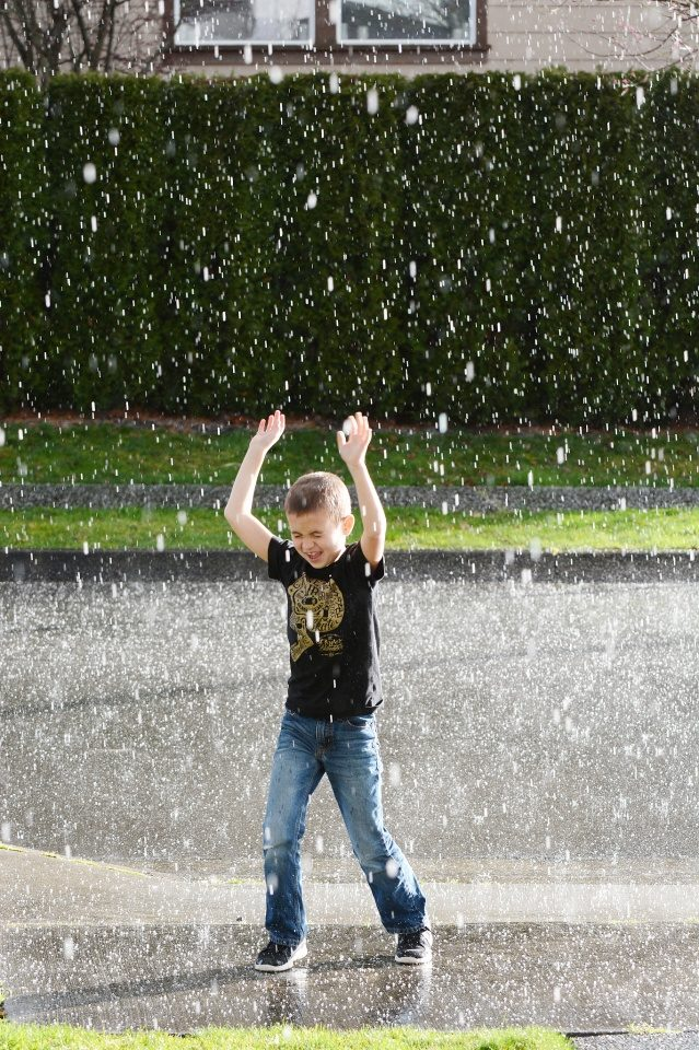 Kid playing in Denver Colorado Hail Storm